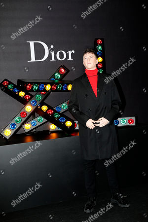 Actor Finnegan Oldfield poses during a photocall before Dior 's men's Fall-Winter 2018/2019 fashion collection presented in Paris, Saturday, Jan.20, 2018