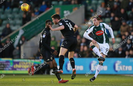 Alex Bruce of Wigan Athletic challenges for the ariel ball with Simon Church of Plymouth Argyle during the Sky Bet League 1 match between Plymouth Argyle and Wigan Athletic on Saturday 20th January 2018 at Home Park, Plymouth, Devon