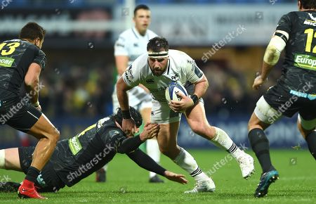 Scott Baldwin of Ospreys is tackled by Arthur Iturria of Clermont Auvergne.