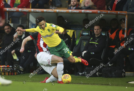 Norwich City's Jamal Lewis and Sheffield United's Ryan Leonard during the EFL Sky Bet Championship match between Norwich City and Sheffield Utd at Carrow Road, Norwich