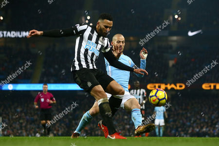 Stock Picture of James Lascelles of Newcastle United defends against David Silva of Manchester City