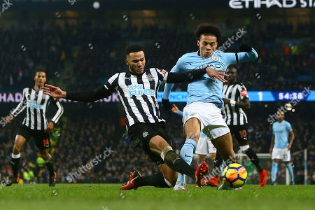 Stock Image of James Lascelles of Newcastle United puts in a last ditch tackle on Leroy Sane of Manchester City