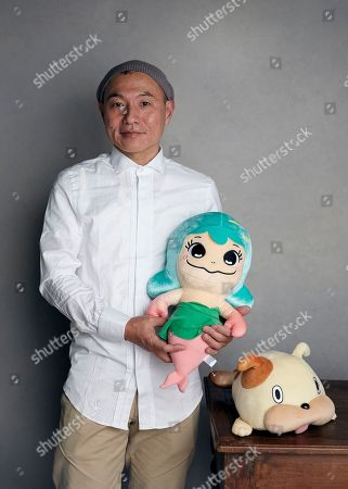 """Director Masaaki Yuasa poses for a portrait with characters Lu and Merdoggie to promote the film, """"Lu Over the Wall"""", at the Music Lodge during the Sundance Film Festival, in Park City, Utah"""