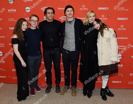 "Paul Dano, Zoe Kazan, Jake Gyllenhaal, Carey Mulligan, Ed Oxenbould, Zoe Colletti. Paul Dano, third from right, director/co-writer of ""Wildlife,"" and his girlfriend Zoe Kazan, far right, pose with cast members, from left, Zoe Colletti, Ed Oxenbould, Jake Gyllenhaal and Carey Mulligan at the premiere of the film at the 2018 Sundance Film Festival, in Park City, Utah"