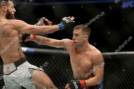 Kyle Bochniak, Brandon Davis. Kyle Bochniak, right, hits Brandon Davis during a mixed martial arts bout at UFC 220, in Boston. Bochniak won via decision