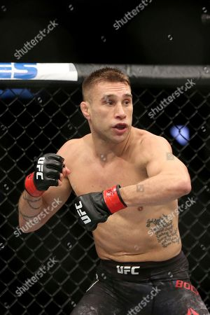 Kyle Bochniak in a action against Brandon Davis during a mixed martial arts bout at UFC 220, in Boston. Bochniak won via decision