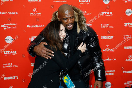 """Terry Crews, Nina Yang Bongiovi. Actor Terry Crews, right, and producer Nina Yang Bongiovi, left, greet each other at the premiere of """"Sorry To Bother You"""" during the 2018 Sundance Film Festival, in Park City, Utah"""