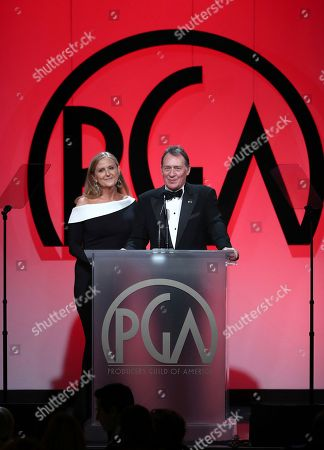 Lori McCreary, Gary Lucchesi. Lori McCreary, left, and Gary Lucchesi speak at the 29th Producers Guild Awards presented by Cadillac at Beverly Hilton, in Beverly Hills, Calif