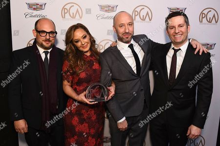 """Eli Holzman, Leah Remini, Myles Reiff, Aaron Saidman. Eli Holzman, from left, Leah Remini, Myles Reiff, and Aaron Saidman pose with the award for outstanding producer of non-fiction television for """"Leah Remini: Scientology and the Aftermath"""" at the 29th Producers Guild Awards presented by Cadillac at Beverly Hilton, in Beverly Hills, Calif"""
