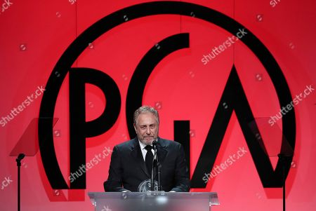 Charles Roven accepts the David O. Selznick achievement award in theatrical motion pictures at the 29th Producers Guild Awards presented by Cadillac at Beverly Hilton, in Beverly Hills, Calif
