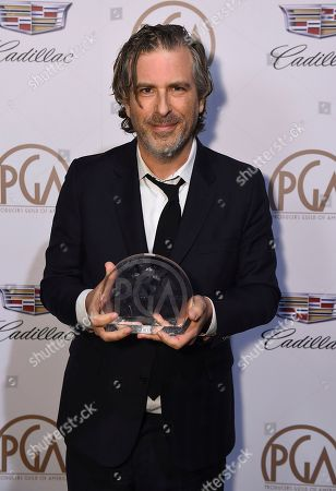 """Brett Morgen poses with the award for outstanding producer of documentary theatrical motion pictures for """"Jane"""" attends the 29th Producers Guild Awards presented by Cadillac at Beverly Hilton, in Beverly Hills, Calif"""