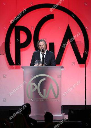 """Brett Morgen accepts the award for outstanding producer of documentary theatrical motion pictures for """"Jane"""" the 29th Producers Guild Awards presented by Cadillac at Beverly Hilton, in Beverly Hills, Calif"""