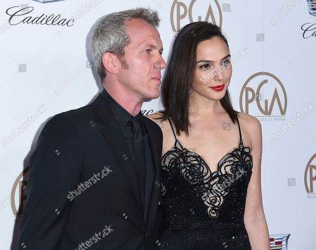 Gal Gadot, Yaron Versano. Gal Gadot, right, and Yaron Versano arrive at the 29th annual Producers Guild Awards at the Beverly Hilton, in Beverly Hills, Calif