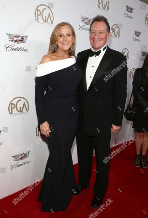 Lori McCreary, Gary Lucchesi. PGA Presidents Lori McCreary, left, and Gary Lucchesi arrive at the 29th Producers Guild Awards presented by Cadillac at Beverly Hilton, in Beverly Hills, Calif
