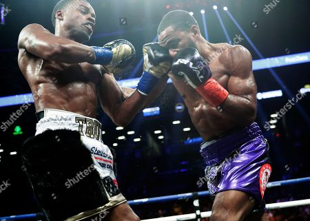 Errol Spence Jr., Lamont Peterson. Errol Spence Jr., left, punches Lamont Peterson during the fifth round of an IBF welterweight championship boxing match, in New York. Spence stopped Peterson in the eighth round