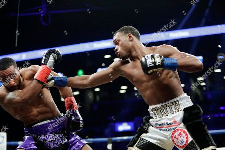 Errol Spence Jr., Lamont Peterson. Errol Spence Jr., right, hits Lamont Peterson during the second round of an IBF welterweight championship boxing match, in New York. Spence stopped Peterson in the eighth round