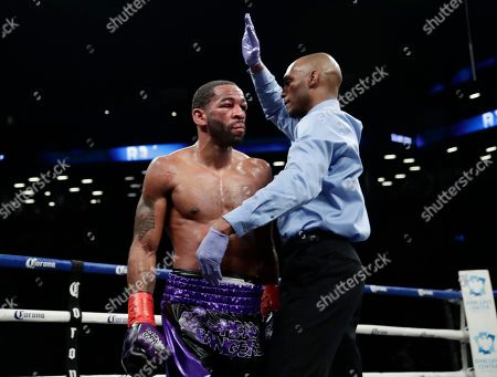 Errol Spence Jr., Lamont Peterson. Lamont Peterson reacts as the referee stops his IBF welterweight championship boxing match against Errol Spence Jr. during the eighth round, in New York. Spence won the bout