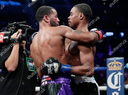 Errol Spence Jr., Lamont Peterson. Lamont Peterson, left, hugs Errol Spence Jr. after an IBF welterweight championship boxing match, in New York. Spence stopped Peterson in the eighth round