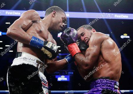 Errol Spence Jr., Lamont Peterson. Errol Spence Jr., left punches Lamont Peterson during the sixth round of an IBF welterweight championship boxing match, in New York. Spence won in the eighth round