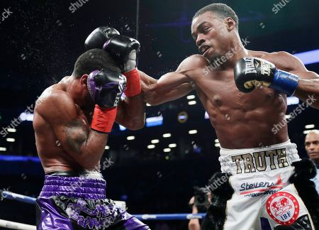 Errol Spence Jr., Lamont Peterson. Errol Spence Jr., right, punches Lamont Peterson during the sixth round of an IBF welterweight championship boxing match, in New York. Spence won in the eighth round