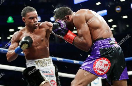 Errol Spence Jr., Lamont Peterson. Errol Spence Jr., left, punches Lamont Peterson during the fifth round of an IBF welterweight championship fight championship boxing match, in New York. Spence Jr. stopped Peterson in the eighth round