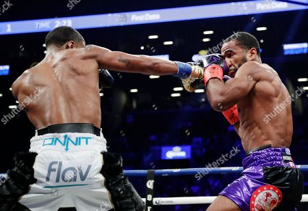 Errol Spence Jr., Lamont Peterson. Errol Spence Jr. punches Lamont Peterson during the first round of an IBF welterweight championship fight championship boxing match, in New York. Spence won in the eighth round