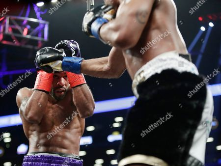 Errol Spence Jr., Lamont Peterson. Lamont Peterson, left, covers up during the second round of an IBF welterweight championship fight against Errol Spence Jr., in New York. Spence won in the eighth round