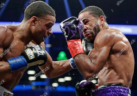 Stock Picture of Errol Spence Jr., Lamont Peterson. Errol Spence Jr., left, punches Lamont Peterson during the third round of an IBF welterweight championship boxing match, in New York. Spence won in the eighth round