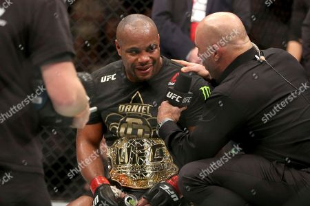 Danie Cormier, Joe Rogan. Daniel Cormier is interviewed by Joe Rogan after a win over Volkan Oezdemir after a light-heavyweight championship mixed martial arts bout at UFC 220, in Boston. Cormier retained the title via 2nd round TKO
