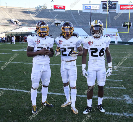 Pasadena CA,..NCAA Football American Team cornerback Joshua Cox Central Michigan University (36), American Team cornerback Amari Coleman Central Michigan University (27) and American Team cornerback Rico Gafford University of Wyoming (26) after the NFLPA Collegiate Bowl American vs National at the Rose Bowl in Pasadena, Ca. on , 2018 (Photo by Jevone Moore)