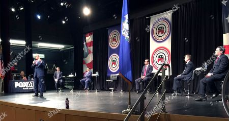Former U.S. Comptroller David Walker makes a point at a debate at Windsor High School in Windsor, Conn., among candidates running or considering a run for governor in 2018. More than two dozen candidates and potential candidates are currently in the crowded field, hoping to somehow set themselves apart