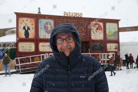 Dougie MacLean poses in the snow outside the Spiegeltent