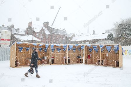 Stock Picture of Jennifer MacLean, artist and wife of musician Dougie MacLean, walks through the snow to the Spiegeltent