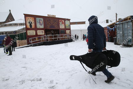 Dougie MacLean makes his way through the snow to the Spiegeltent for his performance