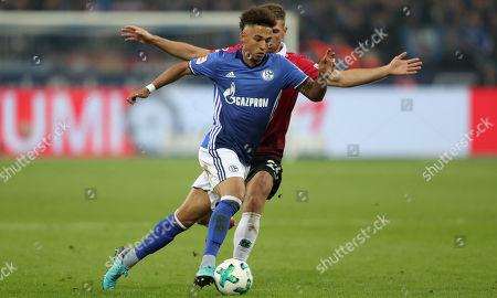 Schalke's Thilo Kehrer (L) and Hannover's Matthias Ostrzolek (R) in action during the German Bundesliga soccer match between FC Schalke 04 and Hannover 96 in Gelsenkirchen, Germany, 21 January 2018.
