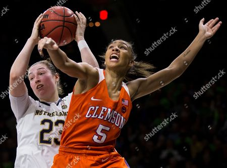 Danielle Edwards, Jessica Shepard. Notre Dame's Jessica Shepard (23) grabs a rebound over Clemson's Danielle Edwards (5) during the second half of an NCAA college basketball game, in South Bend, Ind