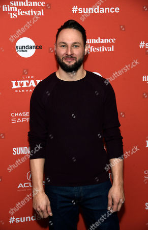 """Director Alexandre Espigares poses at the premiere of his animated film """"White Fang"""" at the 2018 Sundance Film Festival, in Park City, Utah"""