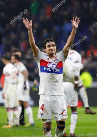 Lyon's Rafael Pereira Da Silva celebrates their victory after the French League One soccer match between Lyon and Paris Saint Germain in Decines, near Lyon, central France
