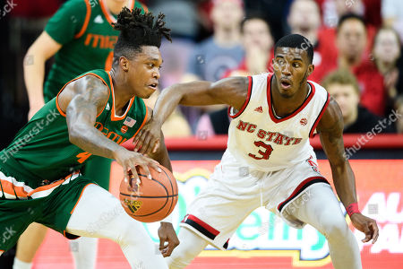 Stock Photo of North Carolina State Wolfpack guard Lavar Batts Jr. (3) and Miami (Fl) Hurricanes guard Lonnie Walker IV (4) during the NCAA College Basketball game between the Miami Hurricanes and the NC State Wolfpack at PNC Arena on in Raleigh, NC