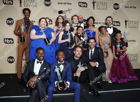 (Standing row L-R) Actors Jermel Nakia, Chrissy Metz, Alexandra Breckenridge, Mandy Moore, Hannah Zeile, Logan Shroyer, Lonnie Chavis, Chris Sullivan, Susan Kelechi Watson, Eris Baker, Milo Ventimiglia, and Faithe Herman, (Seated row L-R) Actors Sterling K. Brown, Niles Fitch, Justin Hartley, and Jon Huertas, winners of Outstanding Performance by an Ensemble in a Drama Series for 'This Is Us,' pose in the press room during the 24th annual Screen Actors Guild Awards ceremony at the Shrine Exposition Center in Los Angeles, California, USA, 21 January 2018. The SAG Awards honors the best achievements in film and television performances.