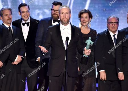 "Matt Walsh, Gary Cole, Nelson Franklin, Timothy Simons, Margaret Colin, Kevin Dunn. Matt Walsh, center, accepts the award for outstanding ensemble in a comedy series for ""Veep"" at the 24th annual Screen Actors Guild Awards at the Shrine Auditorium & Expo Hall, in Los Angeles. Pictured from left are cast members Gary Cole, Nelson Franklin, Timothy Simons, Margaret Colin, and Kevin Dunn"
