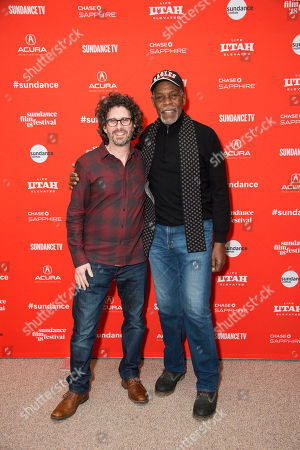 """Joshua Marston, Danny Glover. Director Joshua Marston, left, poses with actor Danny Glover during the premiere of """"Come Sunday"""" at the Eccles Theatre during the 2018 Sundance Film Festival, in Park City, Utah"""