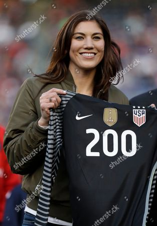 Former United States goalkeeper Hope Solo poses with a jersey with the number 200 during ceremony before an international friendly soccer match against Denmark, in San Diego. Solo appeared in 202 games for the national team, most for any goalkeeper in U.S. history