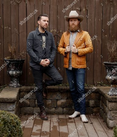 John Osborne, T J Osborne. Left, and John Osborne, of the group Brothers Osborne, pose in Nashville, Tenn