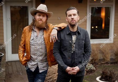 John Osborne, T J Osborne. John, left, and T. J. Osborne, of the group Brothers Osborne, pose in Nashville, Tenn