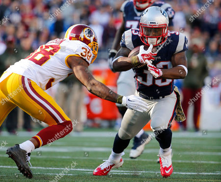 Dion Lewis, Dashon Goldson. New England Patriots running back Dion Lewis tries to get past Washington Redskins' Dashon Goldson (38) during a NFL football game at Gillette Stadium in Foxborough, Mass