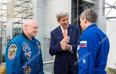 Stock Photo of John Kerry,Scott Kelly. In a photo provided by NASA, U.S. Secretary of State, John Kerry, center, meets with NASA astronaut Scott Kelly, left, and Roscosmos cosmonaut Mikhail Kornienko, right, to discuss their year aboard the International Space Station, in Moscow, Russia. Kelly and Kornienko's year long mission is providing valuable data about how the human body adjusts to weightlessness and long-duration spaceflight, which will inform future human missions on the journey to Mars