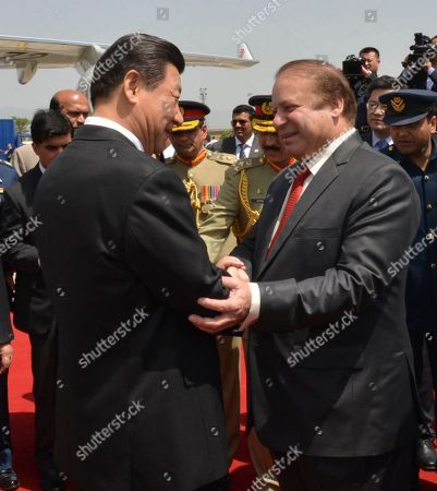 Xi Jinping, Nawaz Sharif. In this photo provided by Pakistan's Press Information Department, Pakistan's Prime Minister Nawaz Sharif's right, receives Chinese President Xi Jinping at Nur Khan airbase in Islamabad, Pakistan, . Xi arrived for a two-day visit during which the two sides will launch an ambitious $45 billion economic corridor linking Pakistan's port city of Gwadar with western China