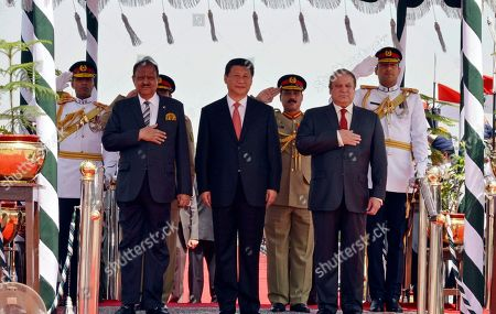 Xi Jinping, Mamnoon Hussain, Nawaz Sharif. In this photo provided by Pakistan's Press Information Department, Chinese President Xi Jinping, center, reviews an honor guard with Pakistan's President Mamnoon Hussain, left, and Prime Minister Nawaz Sharif, right, at Nur Khan airbase in Islamabad, Pakistan, . Xi arrived for a two-day visit during which the two sides will launch an ambitious $45 billion economic corridor linking Pakistan's port city of Gwadar with western China
