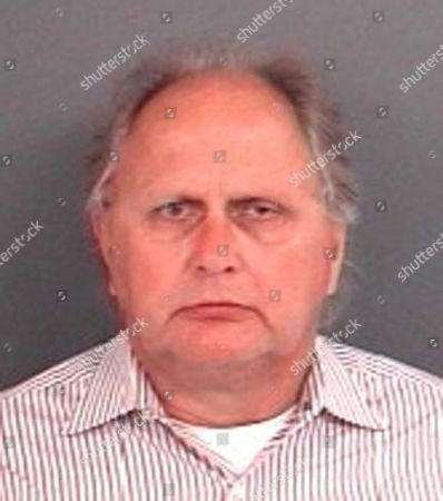 This updated booking photo provided by the Indiana State Police shows Richard Fledderman, the three-term mayor of Batesville, Ind. who has been charged with patronizing a male prostitute. Fledderman paid Randy Wigle-Stevens for sex in June, state police spokesman Sgt. Stephen Wheeles said in a statement . Wigle-Stevens did not tell Fledderman that he has HIV before they had sex and later threatened to go public with details of their encounter unless the mayor paid him extra money, Wheeles said. Fledderman was arrested on the misdemeanor charge Tuesday, and the same day, Wigle-Stevens was charged with a felony count of failure to disclose dangerous communicable disease status and misdemeanor counts of prostitution and intimidation. (Indiana State Police via AP
